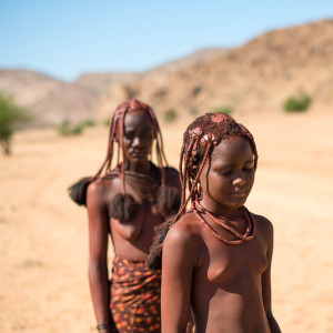 Himba Teenage Girl and Mother in Desert on the Way for Water in