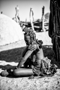 Himba woman putting otjize on in Namibia