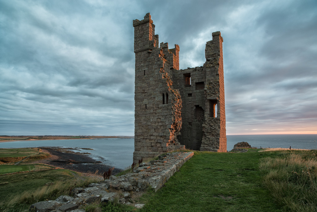 Golden Morning Light on Lilburn Tower Dunstanburgh Castle Northu