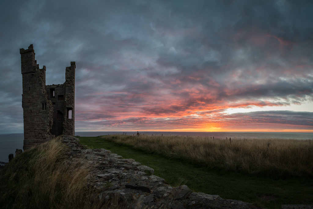 Lilburn Tower, Dunstanburgh Castle Northumberland at Sunrise in